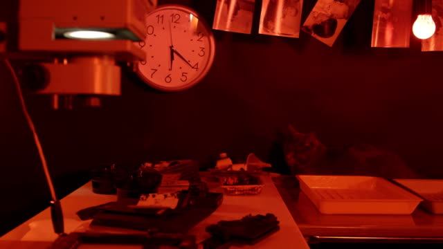 Photography darkroom with red lighting full of magic video