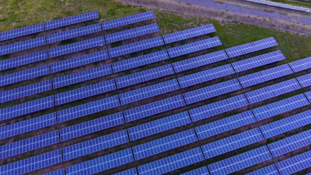 Photovoltaic Panels in Solar Power Station with Sunlight and Reflection video