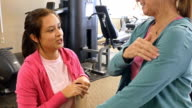 Physical therapist evaluates senior female client video