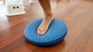 Physical therapy on rubber balance ball video
