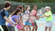 Physically challenged teenager in group tennis lesson video