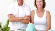 Physiotherapist and patient smiling at camera video