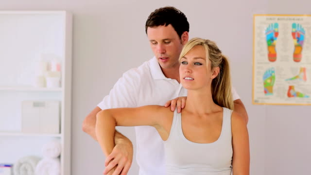 Physiotherapist manipulating patients arm video