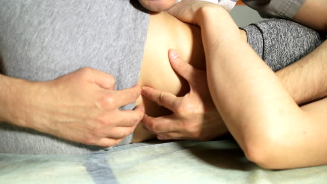 Physiotherapist working on a patient in a room video