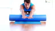 Physiotherapy patient using foam roller video
