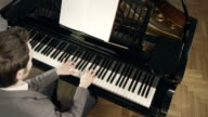 Pianist composing music video