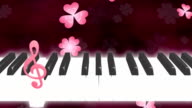 Piano note clover loop dark background video