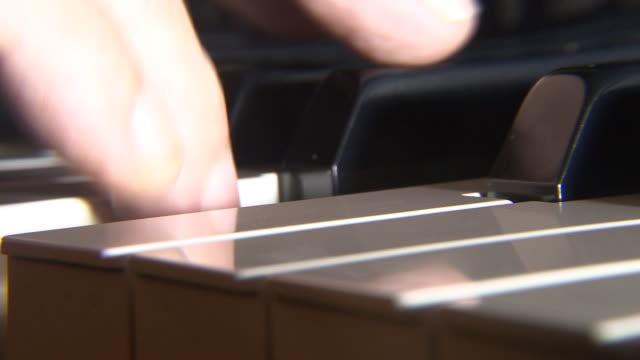 Piano player closeup video