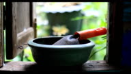 pick gardening tools on the window architrave video