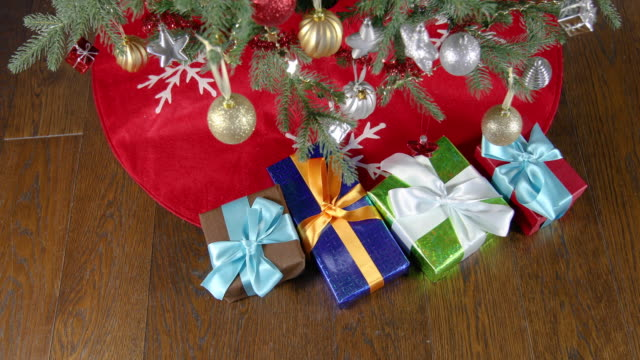picking gift boxes under christmas tree video