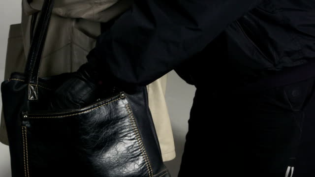 Pickpocket taking wallet from a womans handbag video