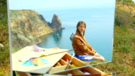 picture - girl on the background of a sea landscape video