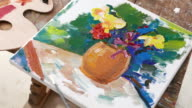 4К Picture of flowers in vase painted by fine artist video