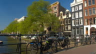 CLOSE UP: Picturesque Amsterdam cityscape from the bridge over river canal video