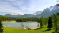 Picturesque lake in the mountains of alps video