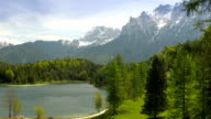 Picturesque lake in the mountains with country house video
