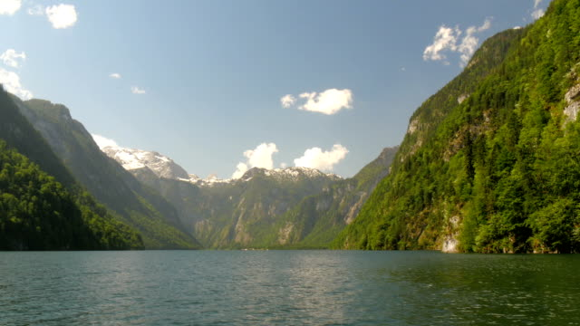 Picturesque lake Koenigssee in mountains of the alps. video