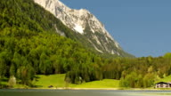 Picturesque lake with mountain and country house. video