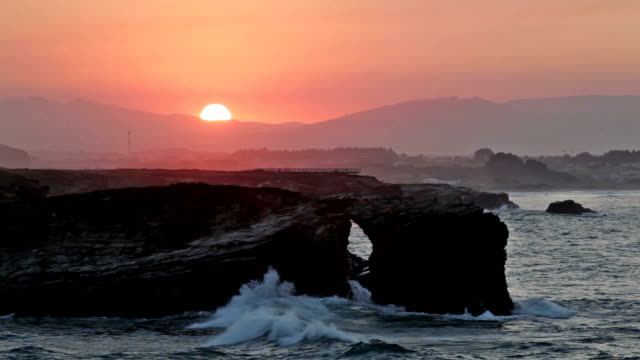 Picturesque sunset over As Catedrais beach in Spain video