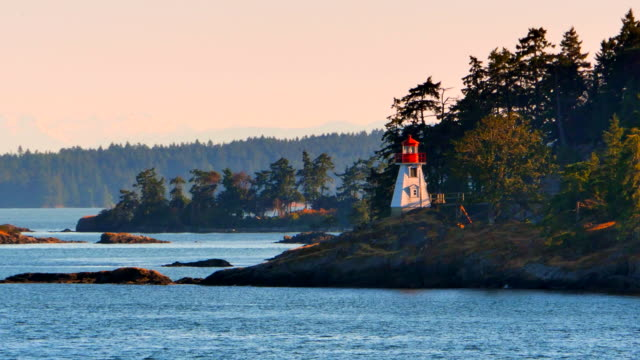 Picturesque West Coast Lighthouse on Rocks, Tracking Shot video
