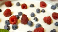 Piece of a pie with fresh berries video