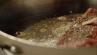 Piece of meat frying in the pan video