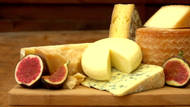 Pieces French of cheese on a wooden table video