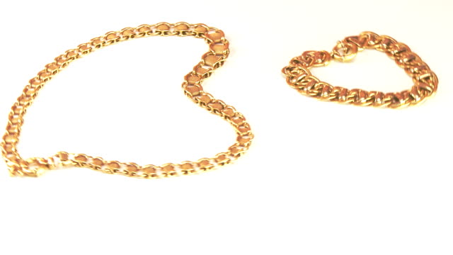 Pieces jewelry in gold rotating video