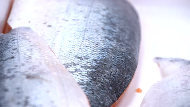 Pieces of salmon fillet on a cutting table video