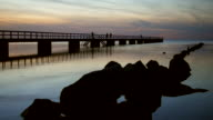 Pier and rocks at twilight video