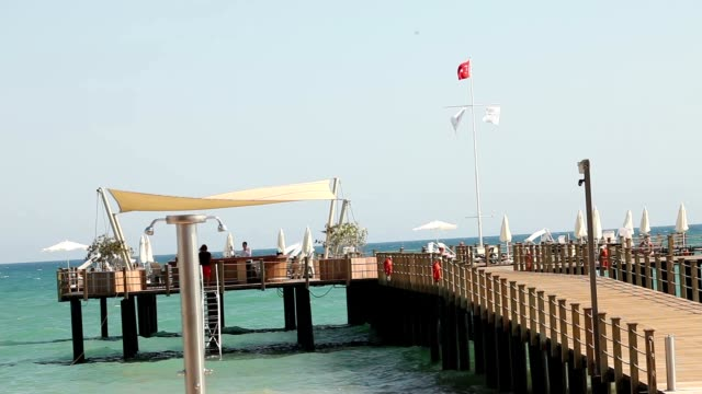 Pier on the Turkish coast, cafe on the pier, waves, good weather video