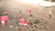 Piggy bank falling and breaking, backwards video