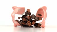 Piggy bank full of money explodes, Slow Motion video
