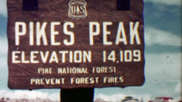 1959: Pikes Peak summit high elevation 14,109 sign family trip. video