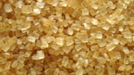 Pile of granulated brown sugar macro dolly shot, view from above video