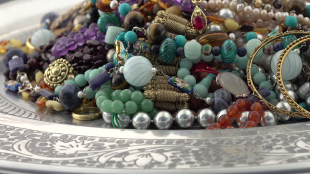 Pile of jewelry turning slowly video
