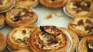 Pile of mini Quiche French style pie with cheese spinach and bacon video