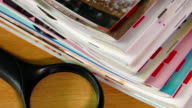 Pile of newspapers and reading glasses video