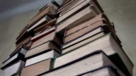 Pile of old books rotates on its axis. video