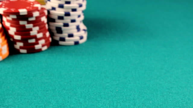 piles of colorful poker chips video