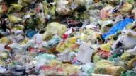 Piles Of Plastic Waste Tilt Up video
