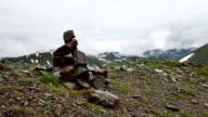 Piles of stones Mark of the right way in High Snowy mountains video
