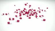 Pill capsules falling video