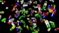 Pills drugs capsules falling slow motion closeup DOF loop video