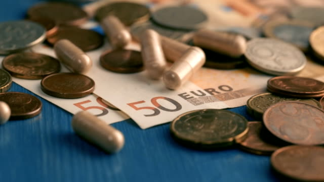 pills falling on euro banknote video