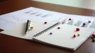 Pills falling on notebook video