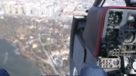 Pilot cabin in moment of fly helicopter above city. Control system. Camera inside. Transportation video