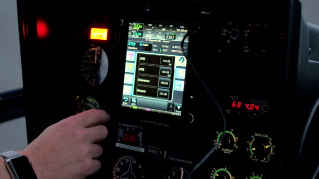 CLOSE UP: Pilot checking out settings on flight control system while flying video