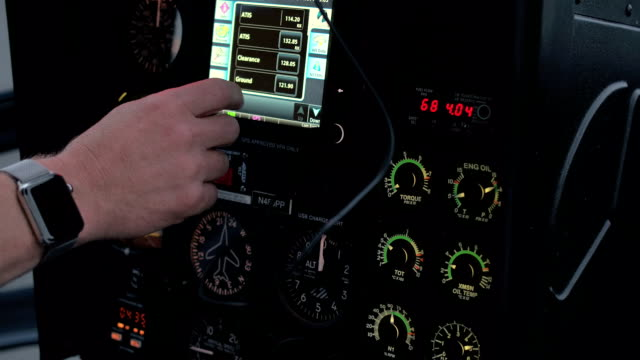 CLOSE UP: A pilot checking out the settings on helicopter flight control system video