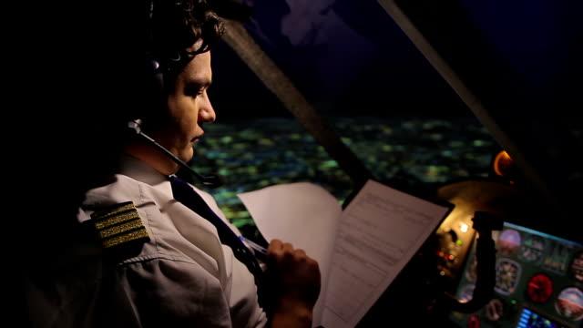 Pilot filling out flight documentation, plane flying in autopilot mode, aviation video